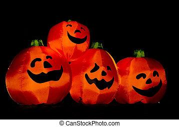 A group of Jack-O-Lanterns on Halloween.