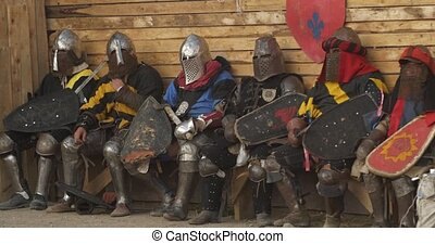 a group of knights in full combat readiness awaiting battle.