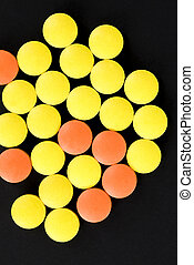 a group of multicolored tablets invented to treat people from modern diseases caused by viruses or bacteria, close up