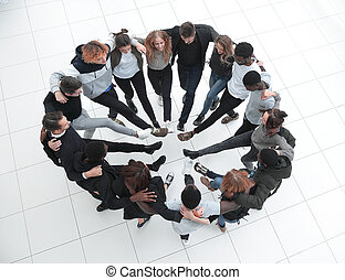 a group of people around foot to foot