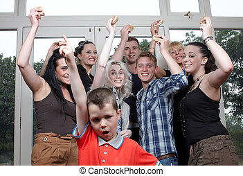 A group of people cheering