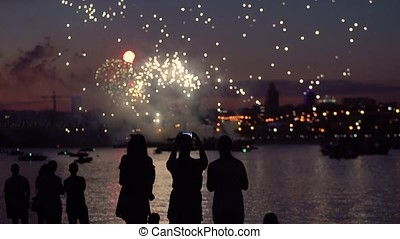 A group of people on the background of fireworks with a good mood
