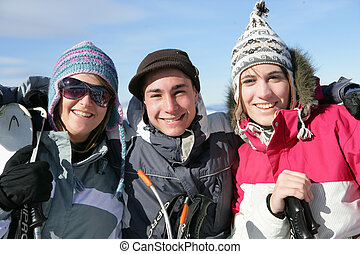 A group of people taking a break from skiing