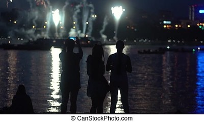 A group of people with a good mood during the fireworks. slow motion. HD
