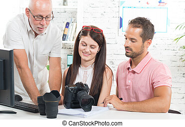 a group of photographers in their office