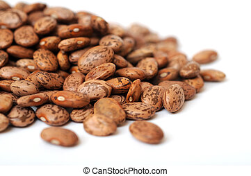 pinto beans - a group of pinto beans on white