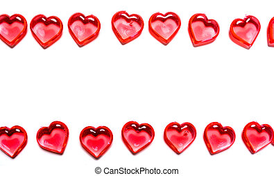 A group of red hearts on a white background with copy space. Valentine's day theme.