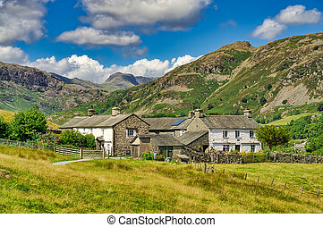 A group of traditional whitwashed cottages in the English Lake District.