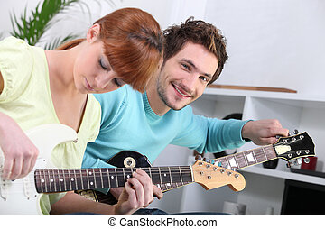 a guitar teacher and his female student