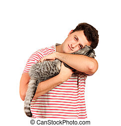 a guy holding a Scottish cat in his arms and feels caressing from him. emotional man isolated on white background