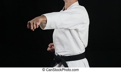 A guy with a black belt does professionally blow