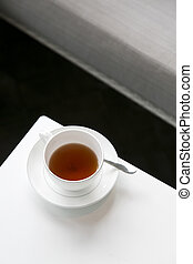 A half cup of tea left on white tab