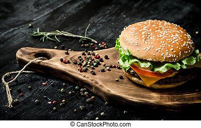 hamburger on a wooden Board.