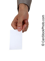 A hand giving a business card.