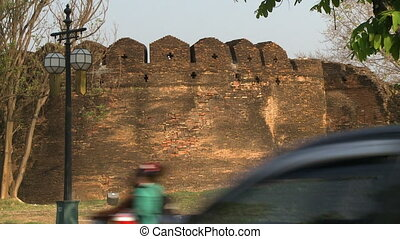 an old brick wall - A hand held, wide shot of a small...