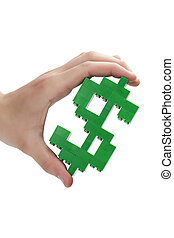a hand holding a dollar sign made on lego