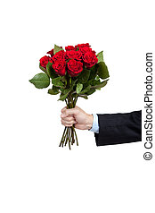 A hand holding a dozen red roses on white - A man\'s hand...