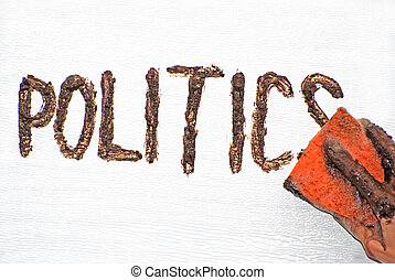 Politics - A hand holding an orange sponge wiping off the...