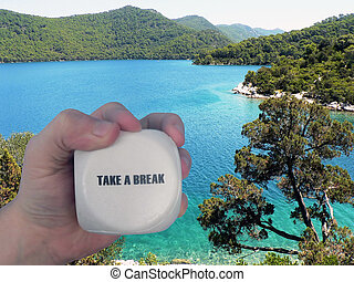 Take a break - A hand holding the message Take a break. In...