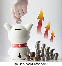 a hand saving coin in piggy bank