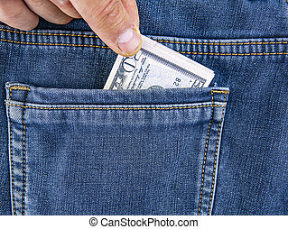 A hand takes money out of the back pocket of jeans.