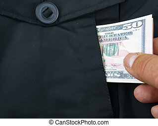 A hand takes out money from a jacket pocket.