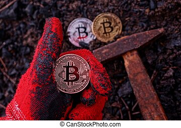 A hand with a gesture of approval and a coin bitcoin over the ground with a hammer
