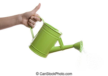 a hand with a watering can over a white background