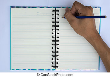 a hand writing on notebook.