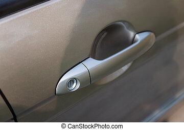 a handle on car door, close-up