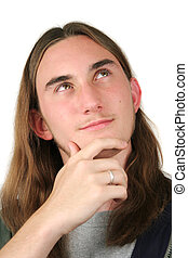 A handsome teenaged boy with long hair, coming up with an...
