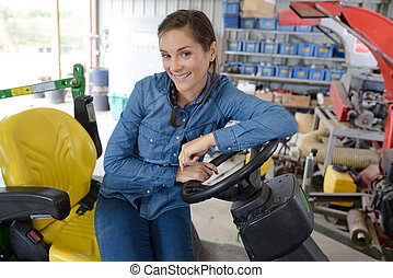 a happy agricultural mechanic in garage