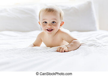 happy baby child play fun in bed