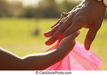 A happy black family - A black girl holding her grandmother'...