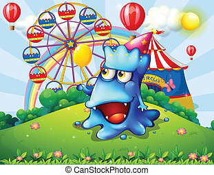 A happy blue monster at the hilltop with a carnival