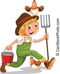 A happy boy holding a pail and a rake