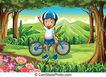 A happy boy with a bike standing in the middle of the forest