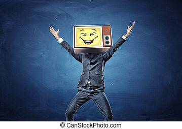 A happy businessman with hands raised in victory has a retro TV with a yellow smiley face instead of his head.