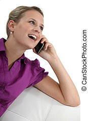A happy businesswoman on the phone.