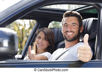 a happy couple in a car