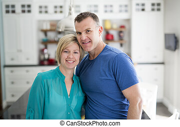 Happy couple in kitchen having fun together