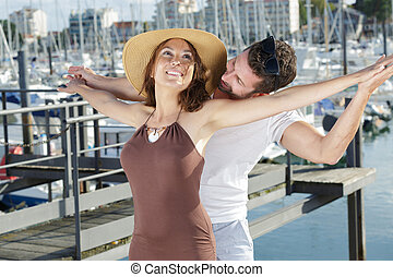 a happy couple in the port