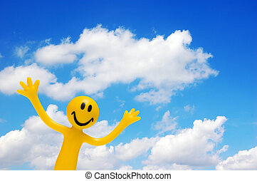 A happy face and blue sky - A happy face with arms raised on...