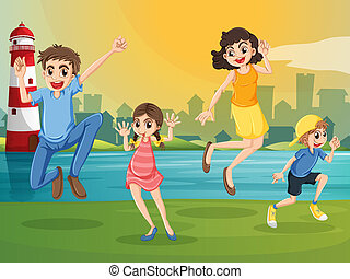A happy family jumping across the lighthouse