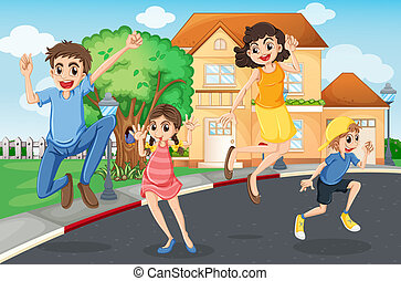 A happy family jumping in the street