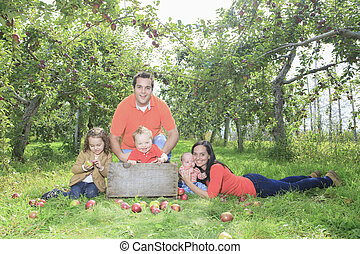 A happy family of four attractive caucasian on apple