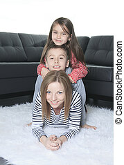 A happy family on the floor of the living room