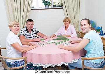 family playing mahjong