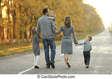 happy family walking in nature