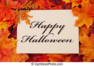 A Happy Halloween card, A beige card with words Happy Halloween over red and orange maple leaf background